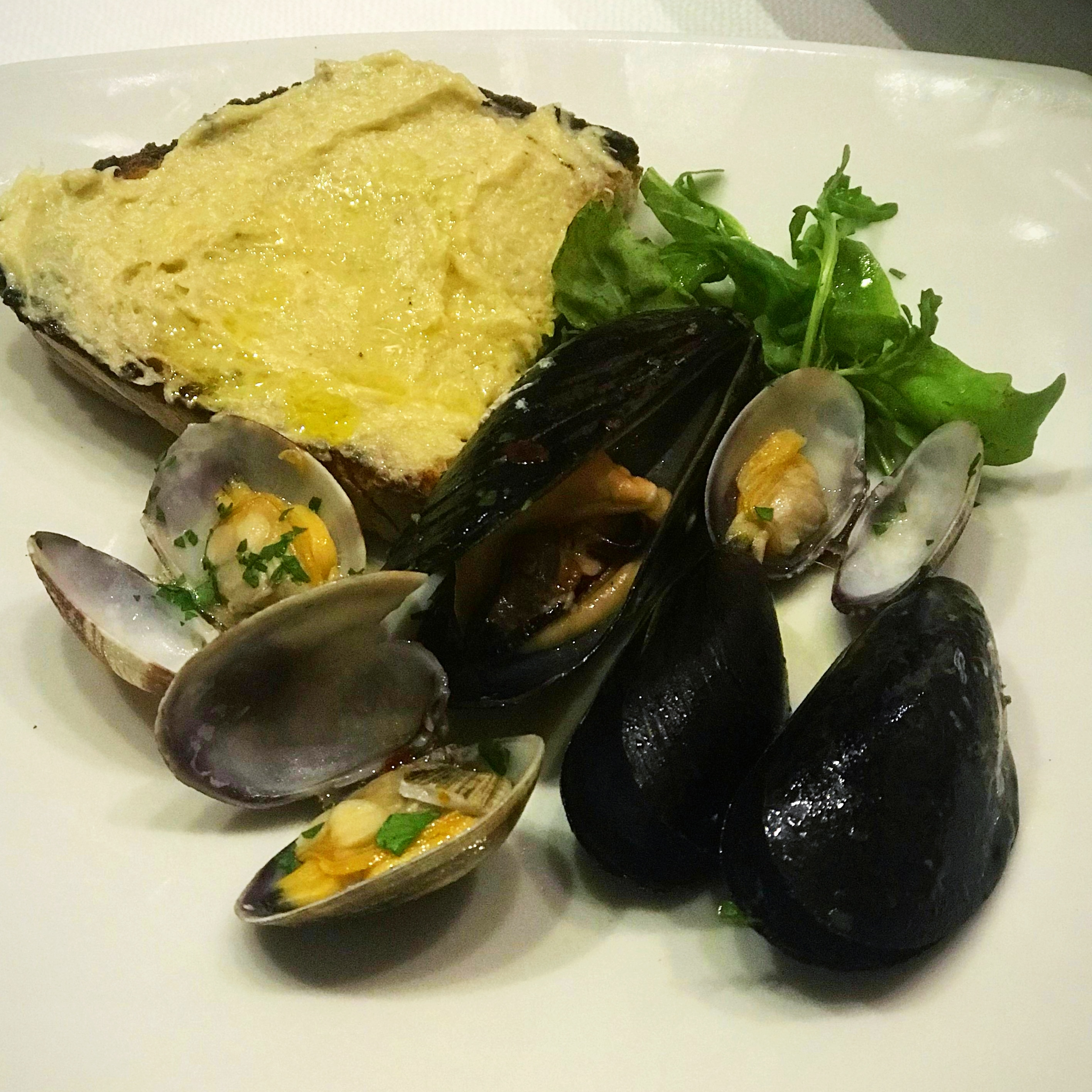 A seafood appetizer from Rome, mussels and bread with a special house sauce