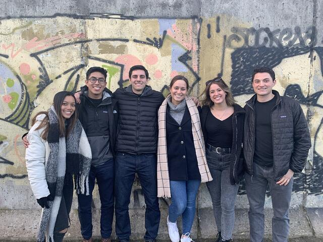 Group photo with friends in front of street art in Berlin
