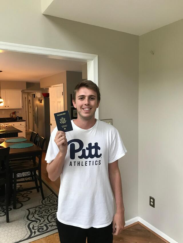 Connor holding passport