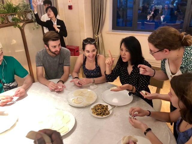 CAPA Shanghai's Program Manager teaching students how to make dumplings