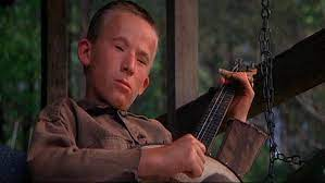 """Billy Redden, the banjo boy in Deliverance. Genetic """"defects"""" were produced by makeup."""