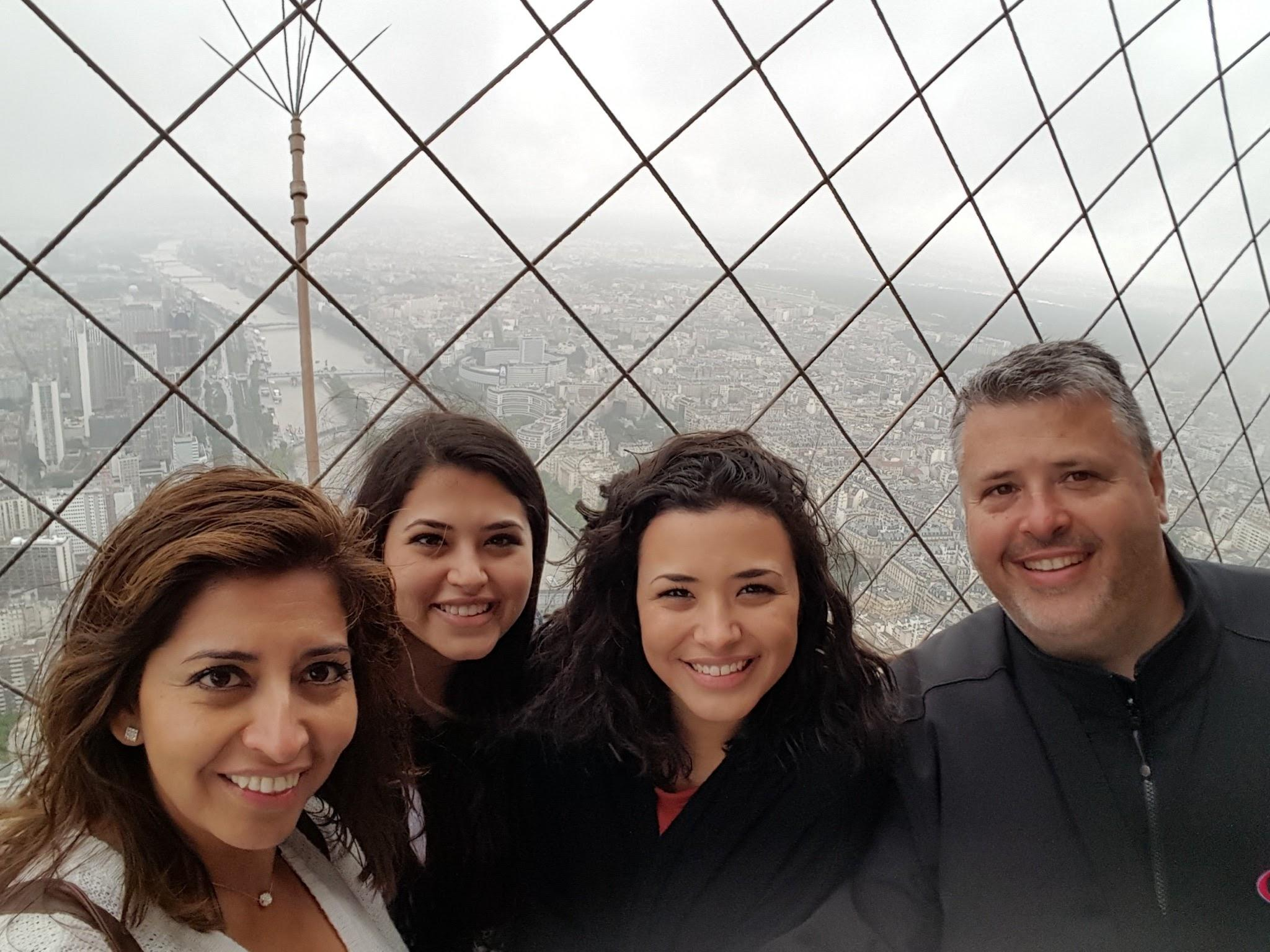 On Top of the Eiffel Tower in Paris with Family