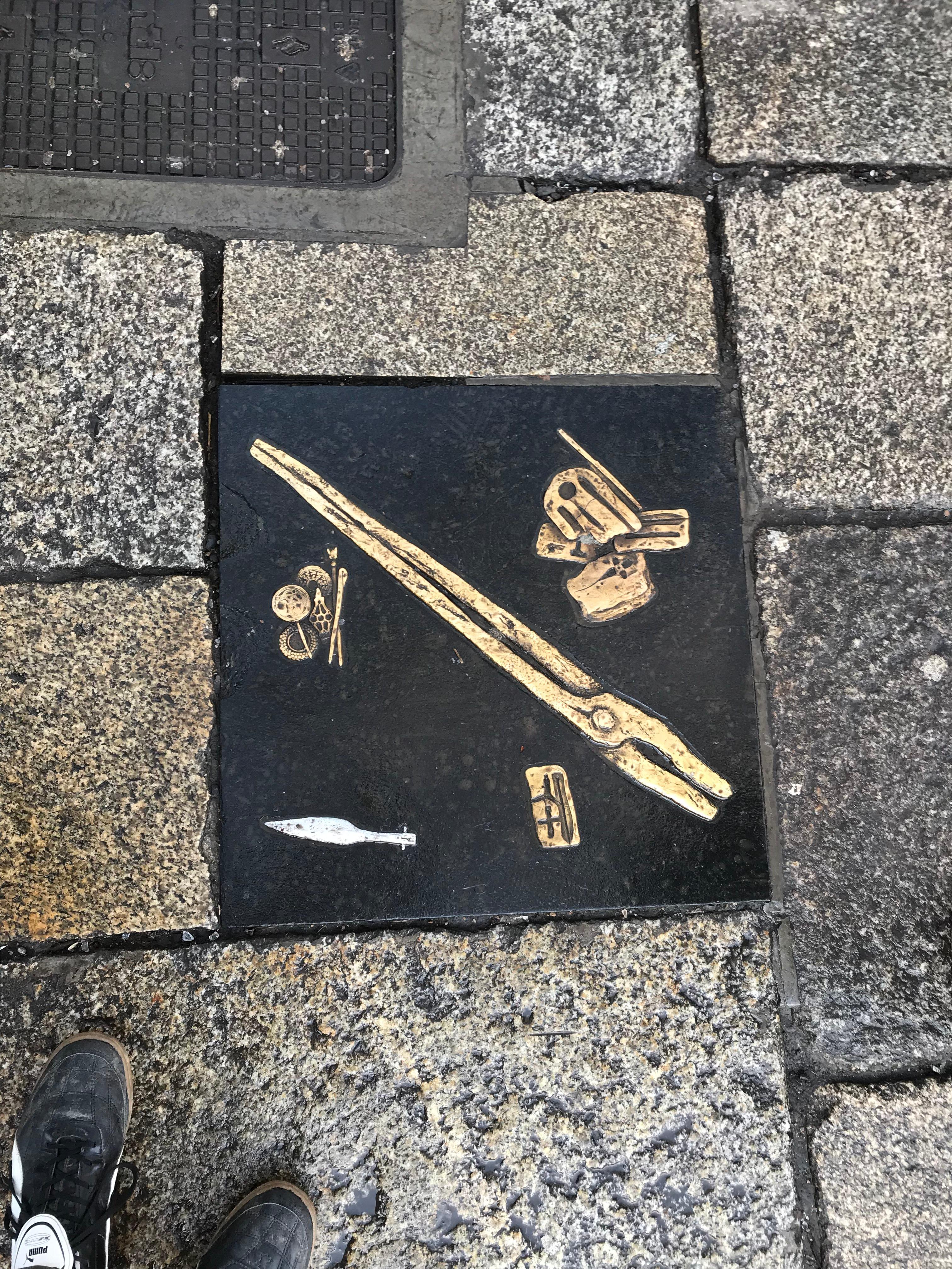 CAPAStudyAbroad_Dublin_Spring2018_From Brandon Mooney - Imprinted Tile with Viking Artifacts on Sidewalk.jpeg