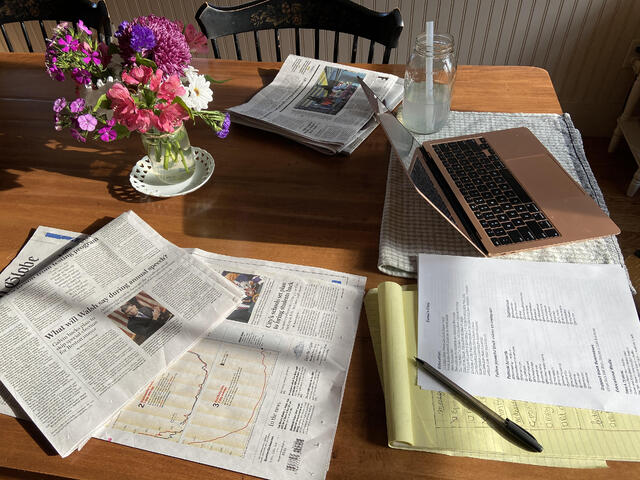 Working from Home - laptop setup with notes on the table.