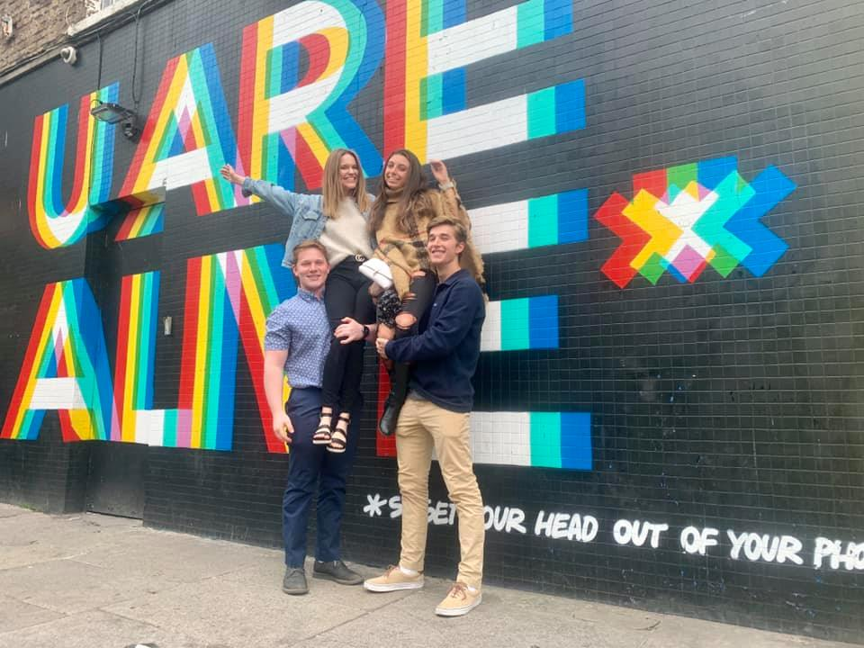 Sara, Daniel, Michael, and I in front of Dublin mural