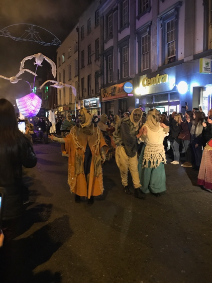 CAPAStudyAbroad_Fall2017_Dublin_From Elizabeth Leahy - Halloween_Gold Mask Performers at the Dublin Macnas Parade.png