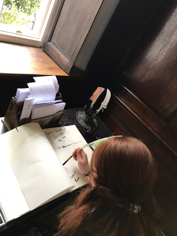 CAPAStudyAbroad_Fall2017_Dublin_From Elizabeth Leahy - Writing in a Visitor's Book at Marsh's Library.png