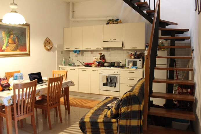 CAPAStudyAbroad_Florence_Spring2018_From Rachel Cholewinski - Apartment Tour_Living Room and Kitchen.png