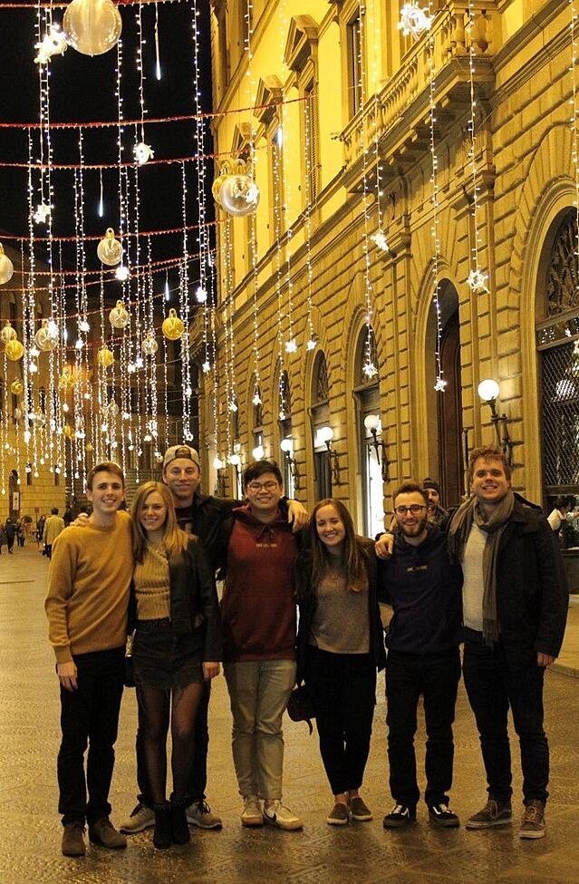 friends under holiday lights in Florence