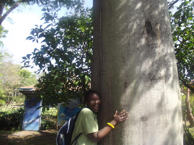 Imani with a tree in Costa Rica