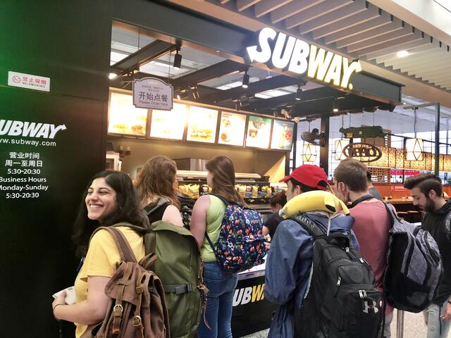 CAPA students buying a Subway sandwich for breakfast at the Shanghai Rail Station