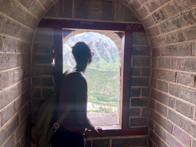 Looking at the view through a window on the Great Wall