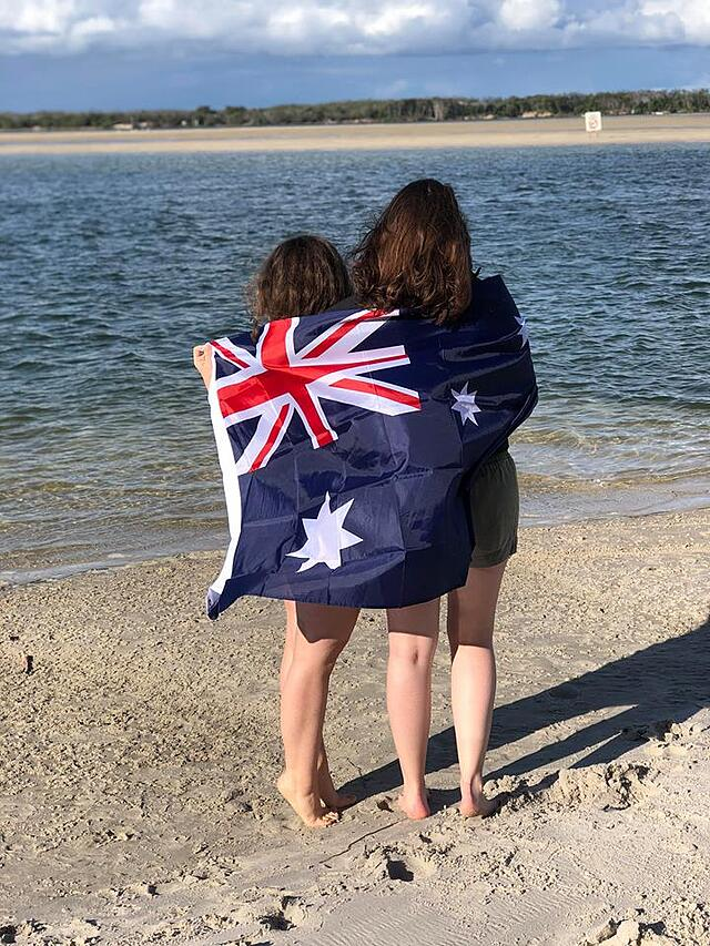An Australian flag draped around students who love studying abroad in Sydney.