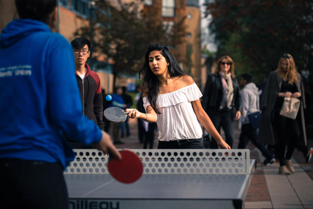 sTUDENTS PLAYING pING pONG ON qUEEN mARY'S cAMPUS