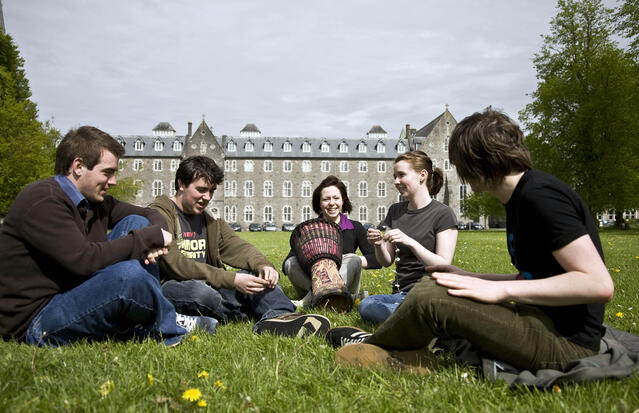 Students Sitting in Circle on Maynooth Lawn