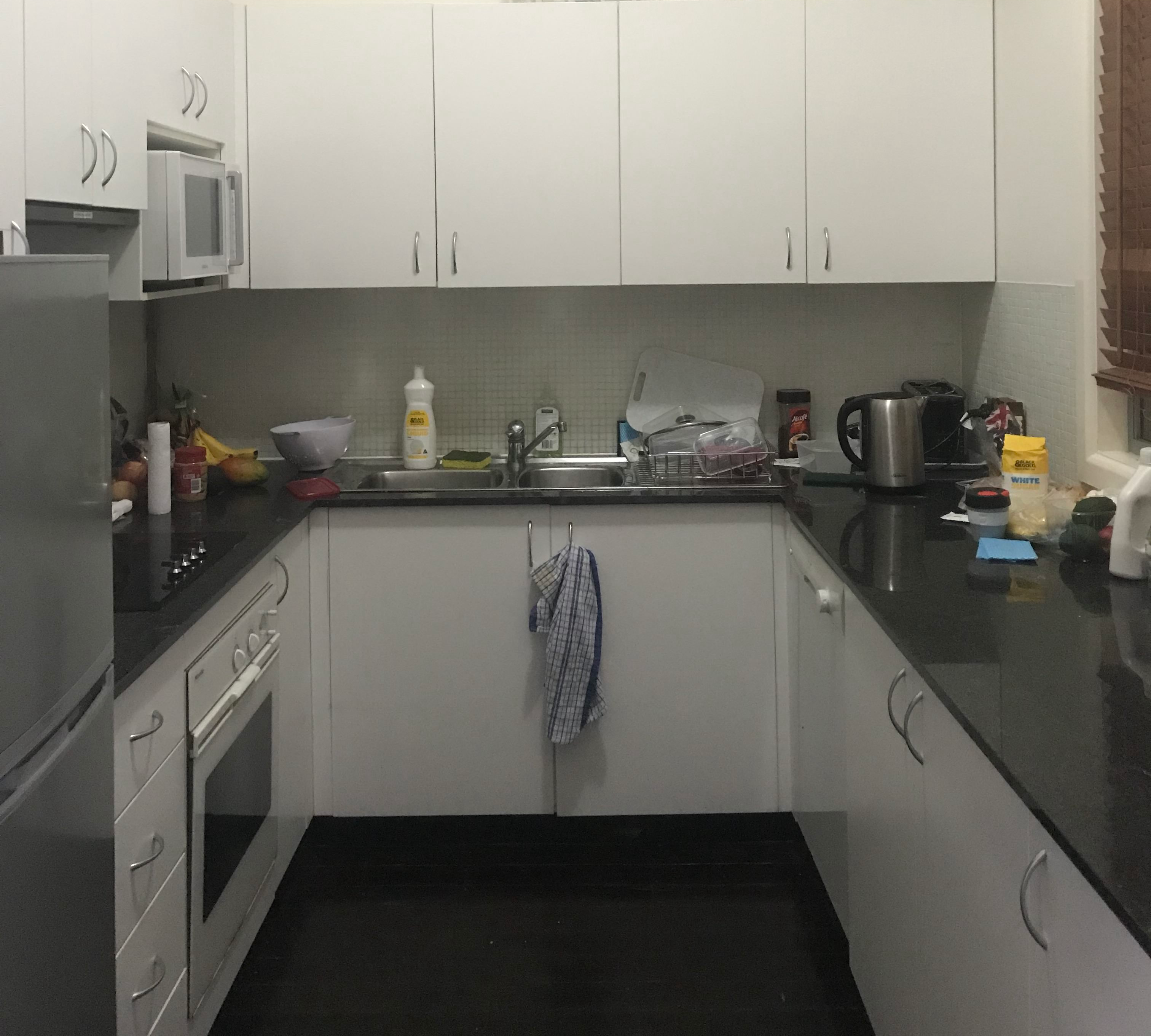 The smaller, enclosed kitchen