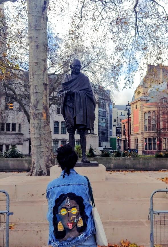 Uma in front of Gandhi Statue