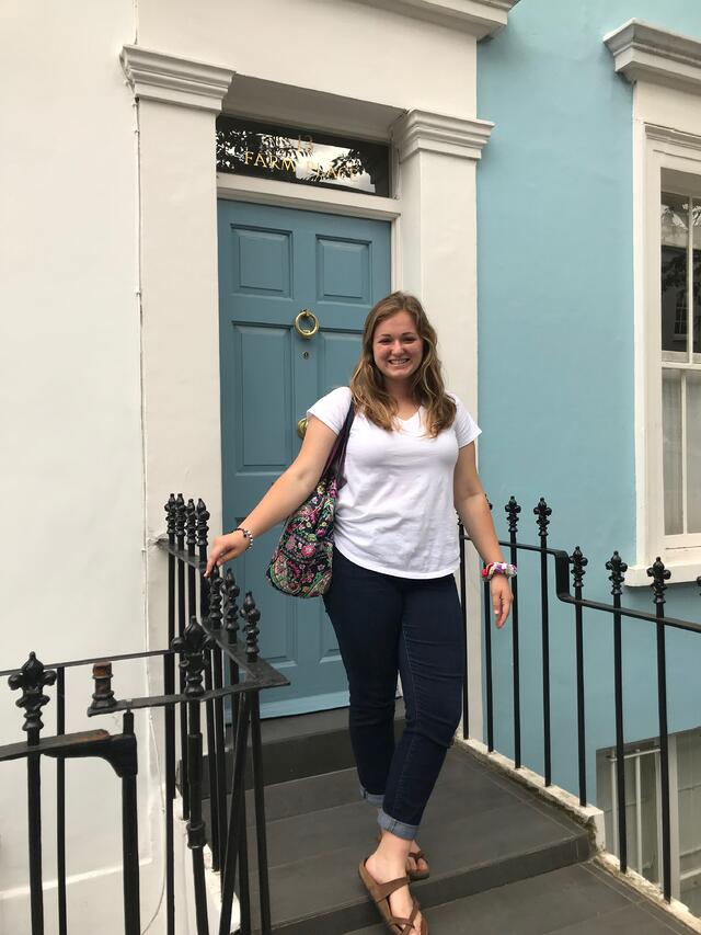 In front of blue house