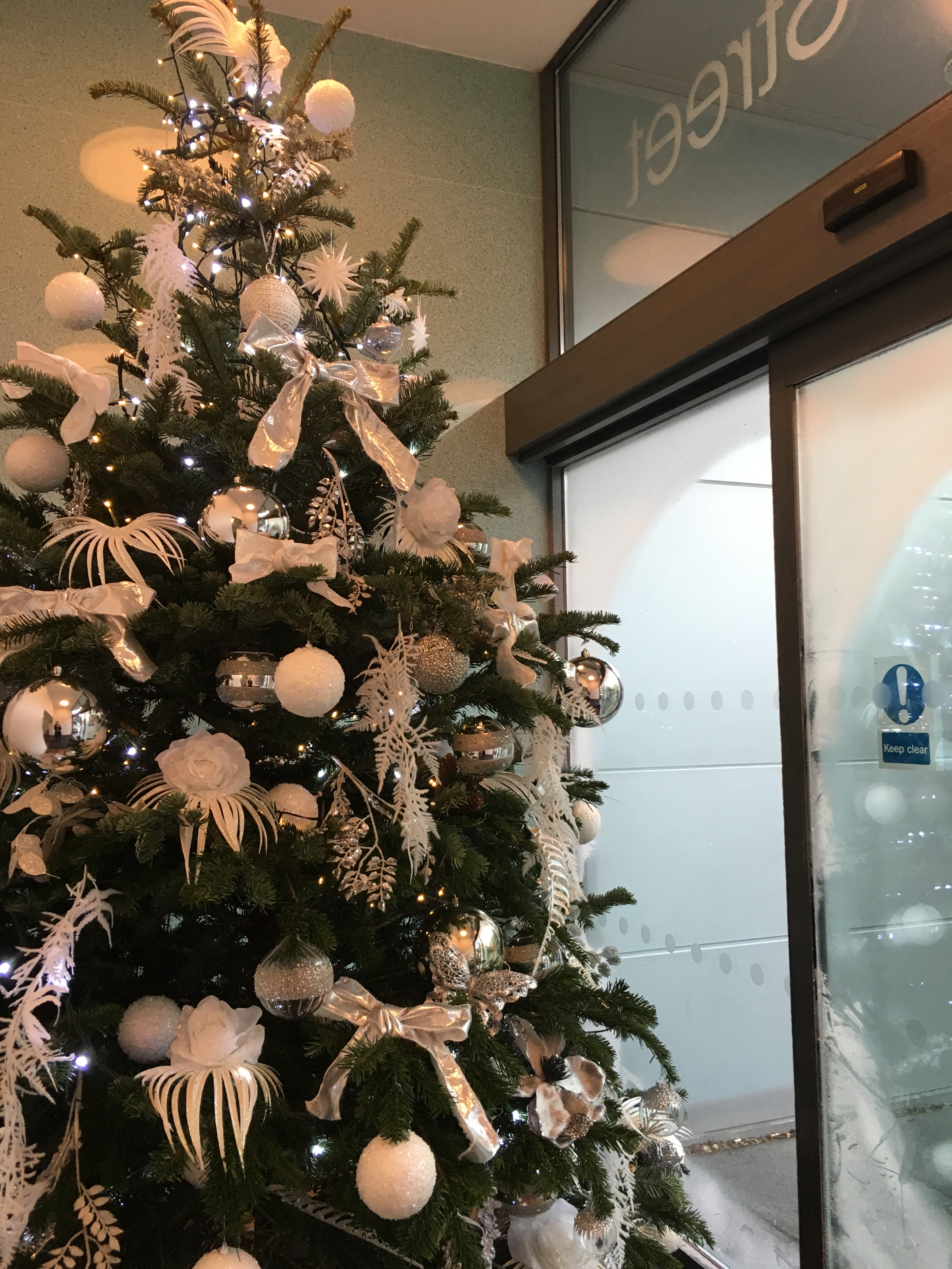 My Internship's Christmas tree is even equipped with little white squirrels underneath it