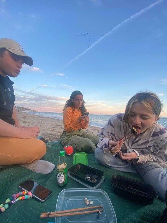 Savanna enjoying a socially-distanced dinner on the beach with her pod in Malibu.