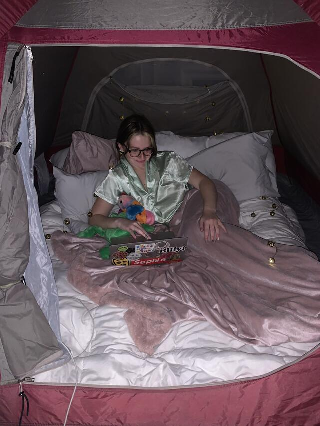 Caption: During the height of the semester when we were feeling most overwhelmed, my roommate and I pitched a tent in our living where we enjoyed a cozy movie night.