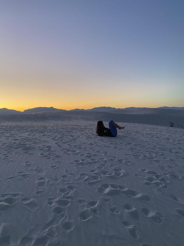 Enjoying the sand dunes at sunset after six hours of driving.